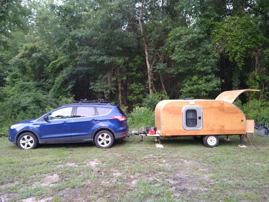 tow vehicle and trailer ready for camping